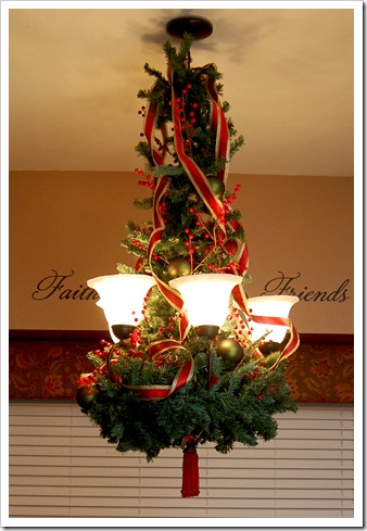 have you ever made a chandelier look like a christmas tree this one is so cute theres even a tutorial on the blog head on over to pearls handcuffs and - Christmas Chandelier Decorations