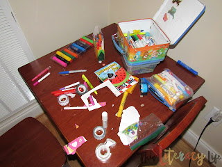 This art table is full of activities children can do on their own to keep up with basic skills such as cutting, coloring, and writing.