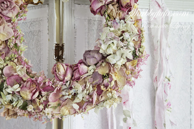 A dried rose wreath with peonies and other pastel flowers. This floral peony wreath is the perfect addition to any shabby chic home.