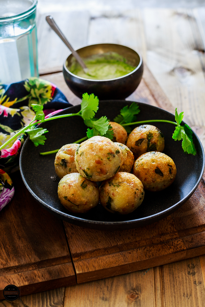 Moriyo Vada, low-fat but super delicious farali dish prepared with Barnyard Millet, various farali flours and spices and cooked with less oil in a panniyaram pan. But one can deep fry too.