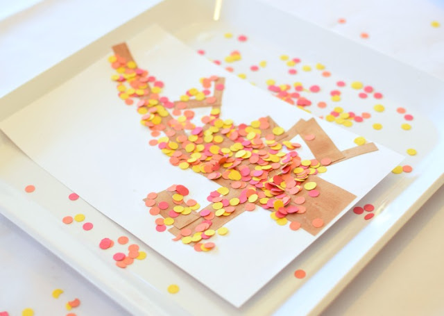 Fall tree craft for toddlers, preschoolers, or kindergartners.  Use hole punch circles in red, orange, and yellow to make autumn leaves!  Great fine motor work!