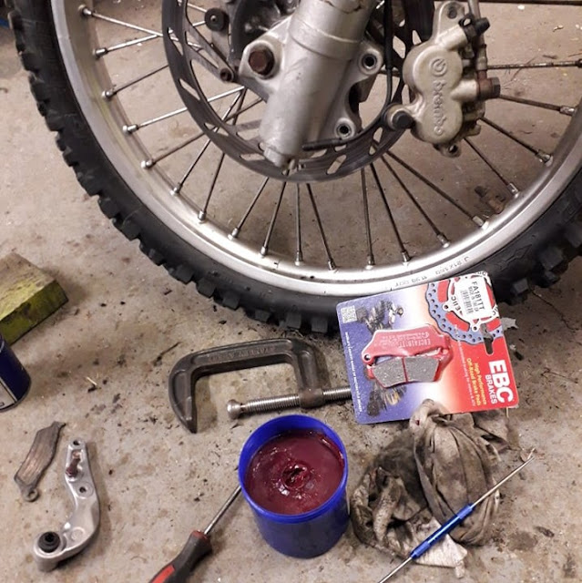 The front brake pads were replaced and the disk given a good clean to remove all the old oil and gunk.