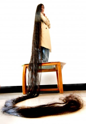 Welcome to FizzyGist Center.: Woman with the longest hair
