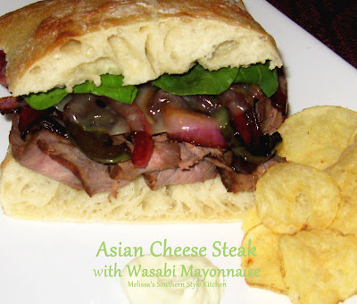 Asian Cheese Steaks With Wasabi Mayonnaise - Who doesn't love a Philly Cheese Steak, right? I was looking for a way to mix it up a little, so I decided to add an Asian twist to this classic cheese steak and this is the end result.