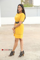 Actress Poojitha Stills in Yellow Short Dress at Darshakudu Movie Teaser Launch .COM 0060.JPG