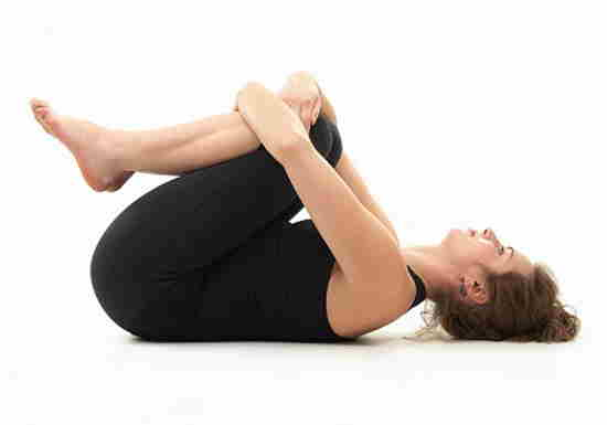 lose belly fat with Wind Easing Pose