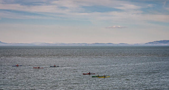 Photo of colourful canoes in the Solway Firth