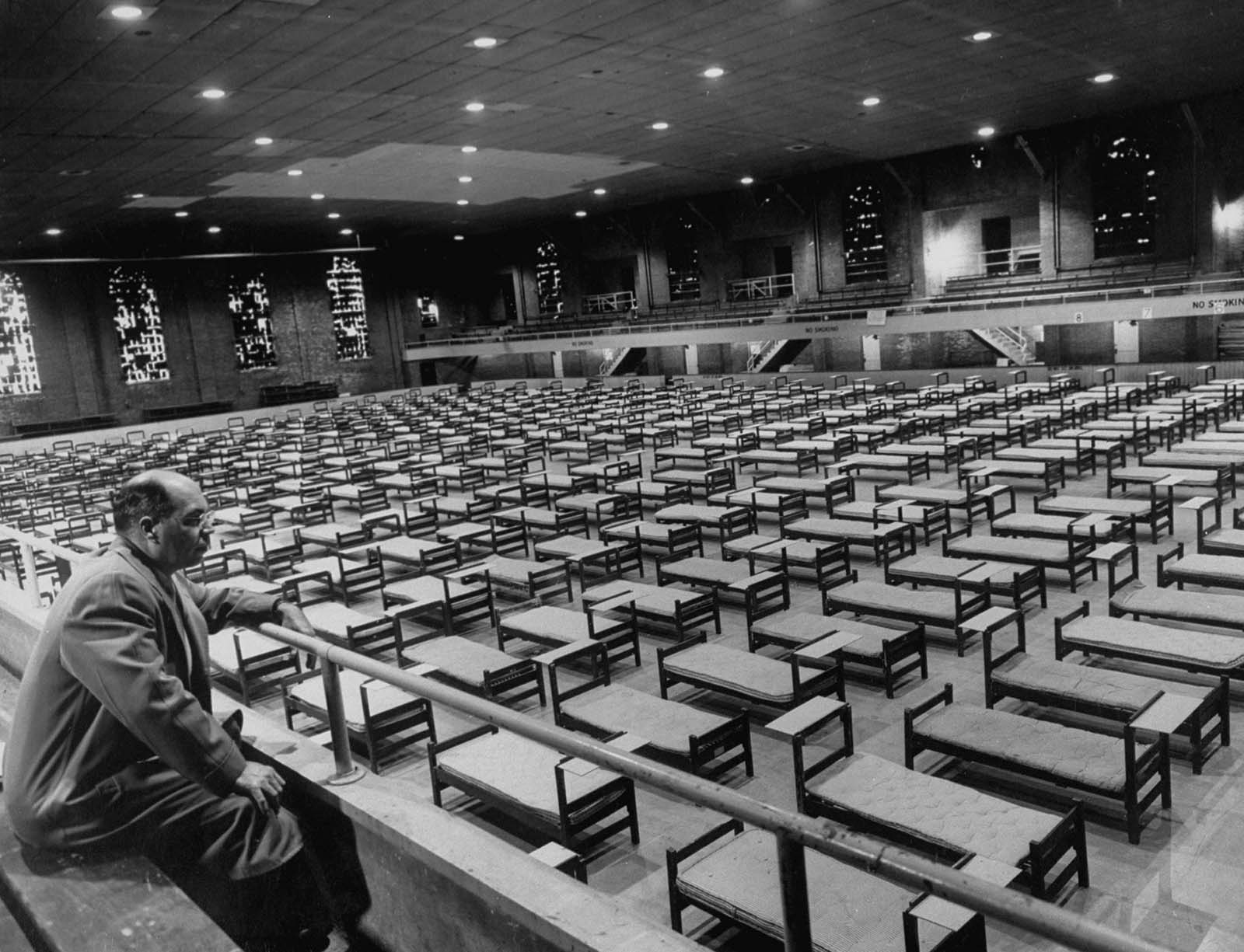 Charles Bowman, acting health officer at the University of Illinois, looked out over the 336 hospital cots set up in an ice rink in anticipation of a rush of flu patients.