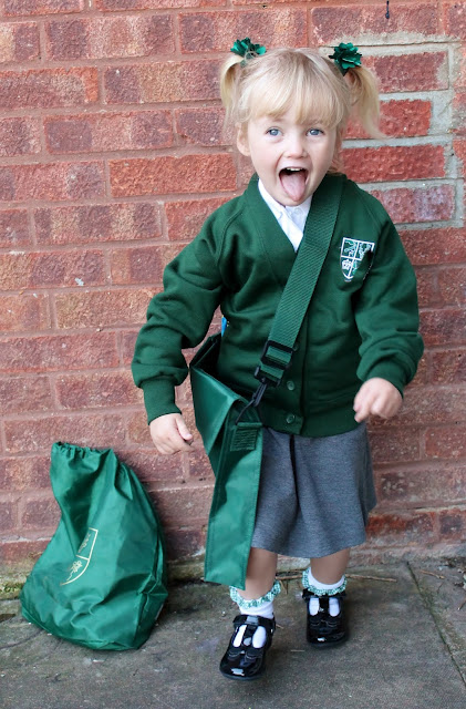 A little girl already for her first day at school reception