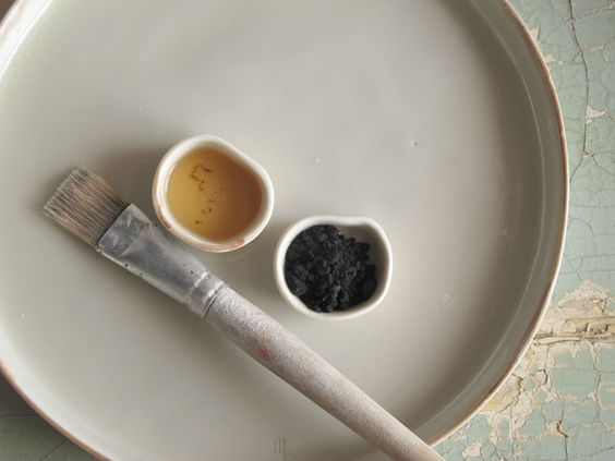 Paintbrush and colors on stoneware - Slow living inspiration with calm, serene, quiet living - found on Hello Lovely Studio