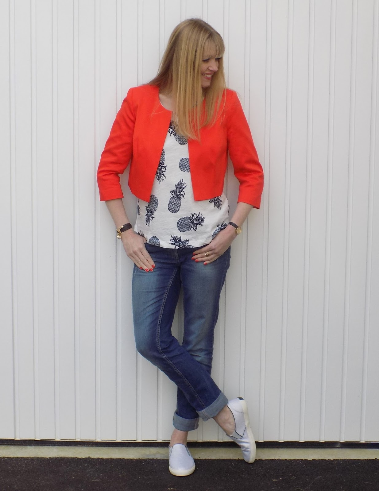 Pineapple top and boyfriend jeans with orange jacket. Redhead wearing orange