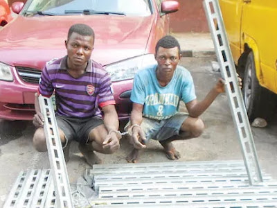 scavenger steal bridge railing lagos