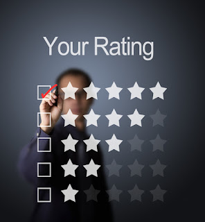 A businessman is checking the box with 5 stars to indicate the optimum timing for employee engagement surveys