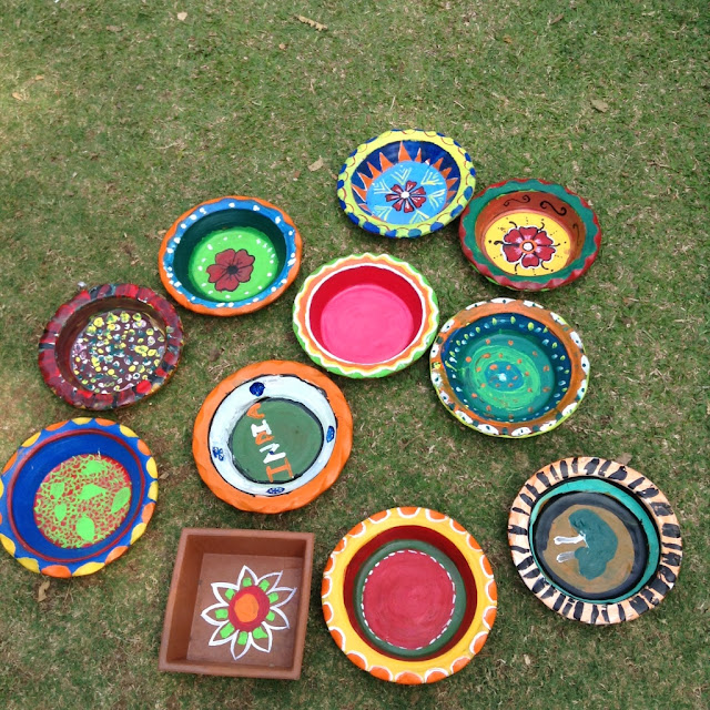 Children celebrate Holi at Pune by painting earthen pots - initiative of Indiaart Gallery and Suyog Mitra Mandal