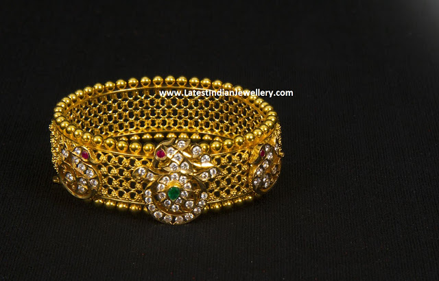 Diamond Motifs Gold Bangle