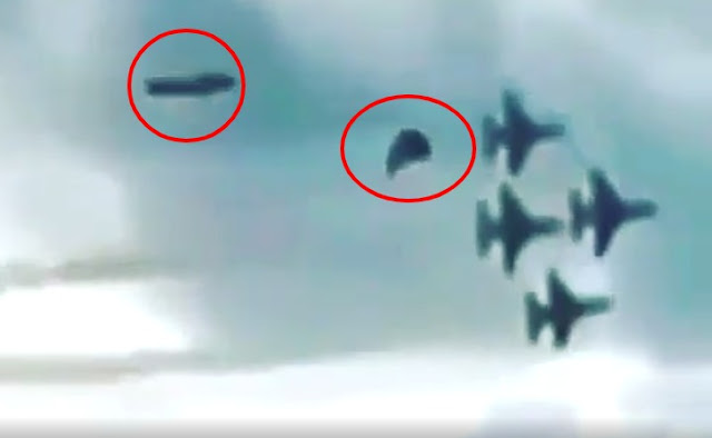 Two-UFOs-following-behind-a-US-Air-Force-Jet-formation.