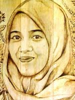 lukisan wajah tunggal dengan teknik pirografi_javaharmony.com