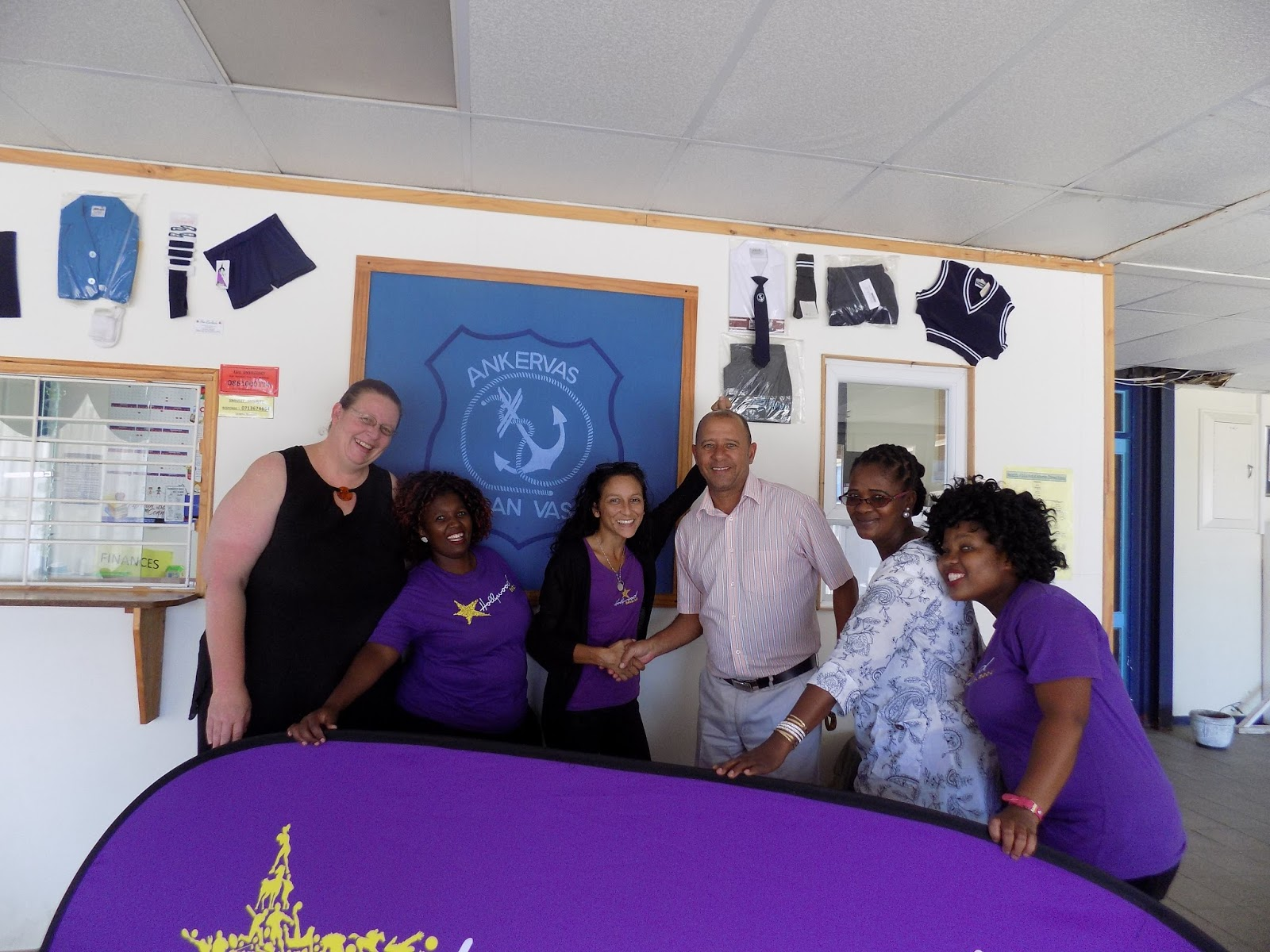 Ankervas staff thank the Hollywoodbets team for a donation of furniture