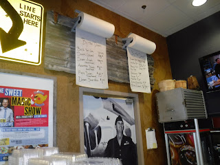 hanging rolls of butcher paper used as menu boards at FlyBoy Donuts in Sioux Falls, South Dakota