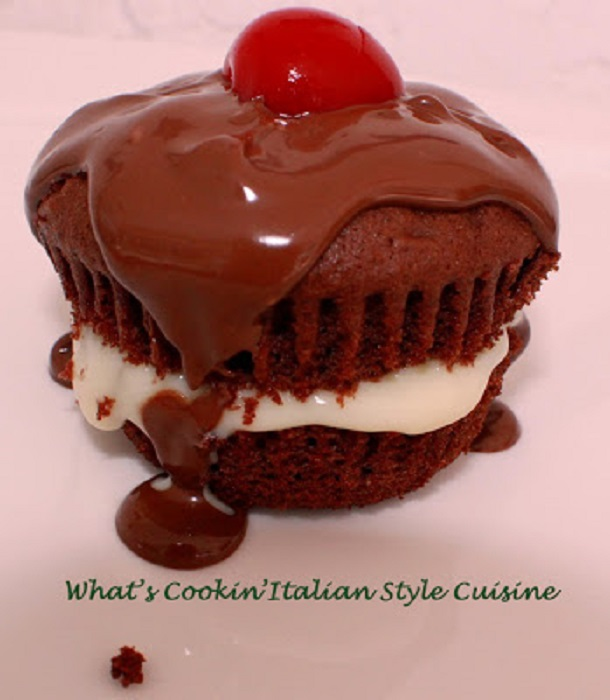 This a Boston Cream Cupcake filled with custard and inside a chocolate cupcake with decadent ganache and cherry on top