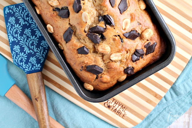 Packed full of chunks of chocolate & crunchy peanuts, this Chocolate Chunk Peanut Butter Banana Bread is a chocolate & peanut butter lover's dream come true.