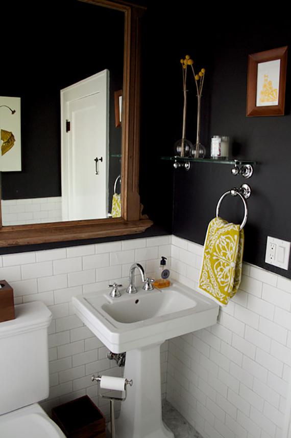 Black and white bathrooms | Black wall and white tiles in the bathroom of Lauren Bradshaw via Design Sponge.
