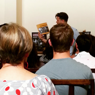 Tim 'Rosso' Ross and his latest book in front of an audience.