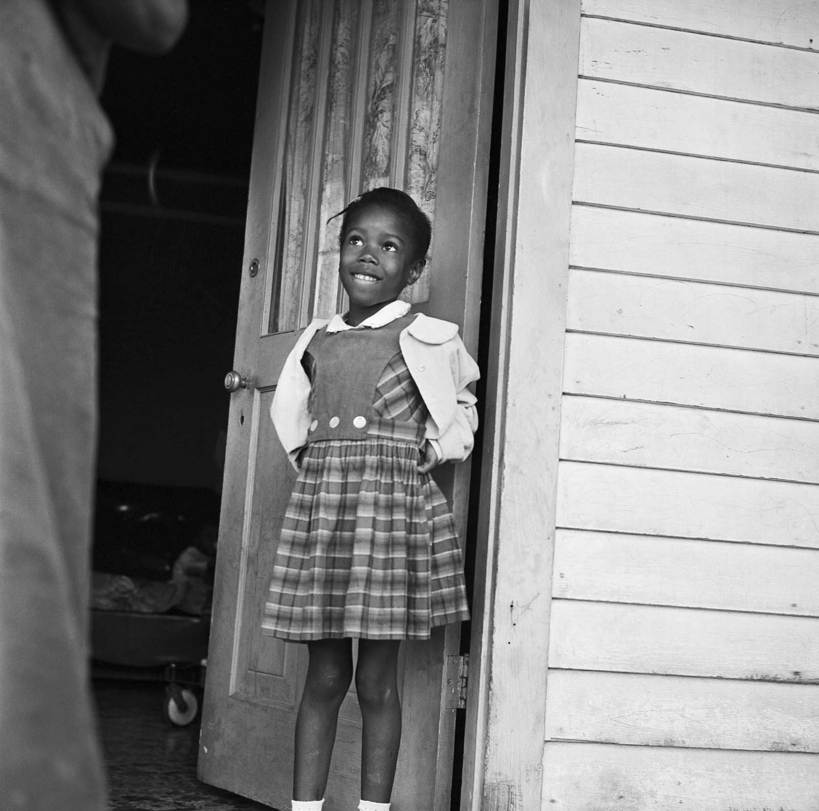 Ruby Nell Bridges at age 6, was the first African American child to attend William Franz Elementary School in New Orleans after Federal courts ordered the desegregation of public schools.