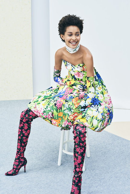 A strapless ball gown in a multi-colored floral print by Richard Quinn