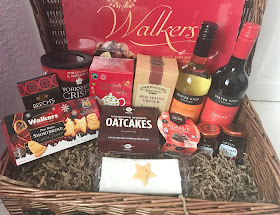 tradition Christmas wicker hamper with treats inside