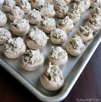 sheet pan with stuffed mushrooms ready to bake