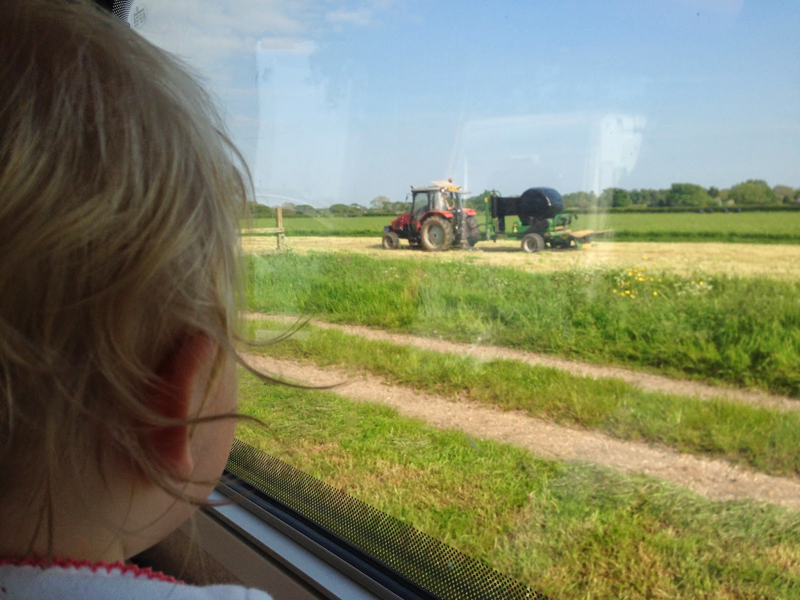 Tin Box Tot sees a tractor out the caravan window