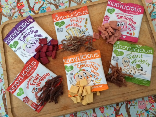 Selection of healthy, Kiddylicious snacks on a chopping board
