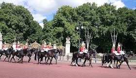 Horse guards parading past the Canade Gate, The Green Park