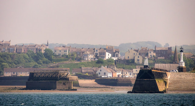 Photo of Maryport through the sea mist at low tide when the basin and harbour dry out