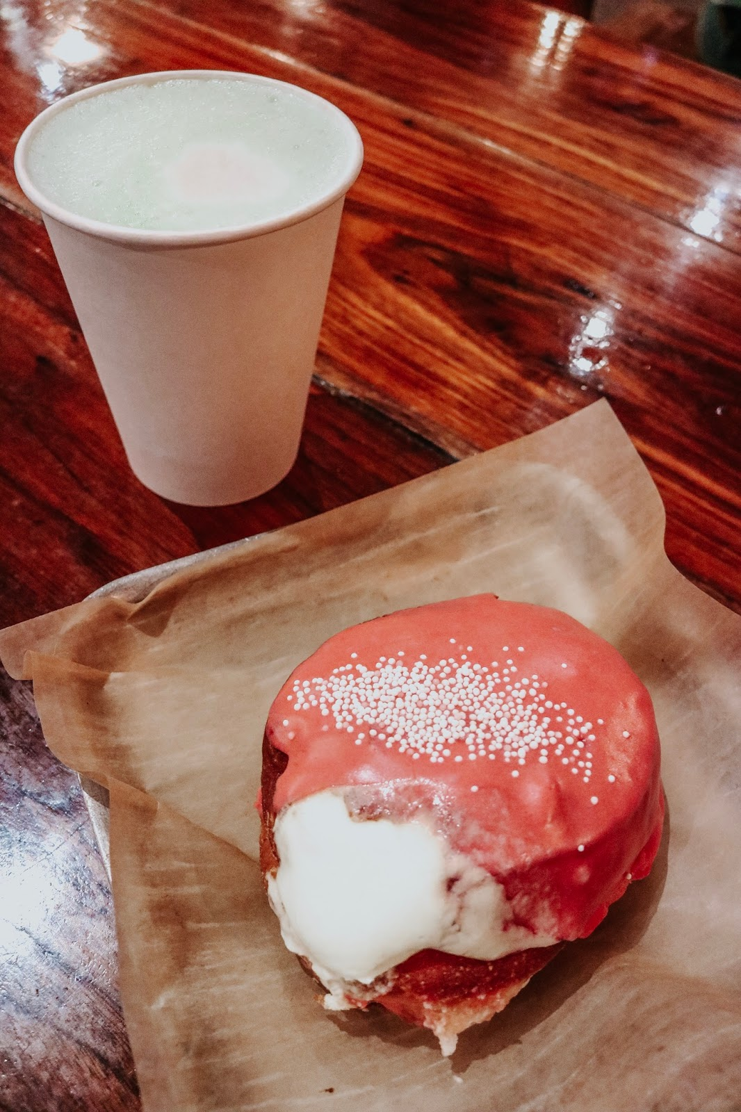 Matcha latte and a raspberry champagne donut at District in New Orleans