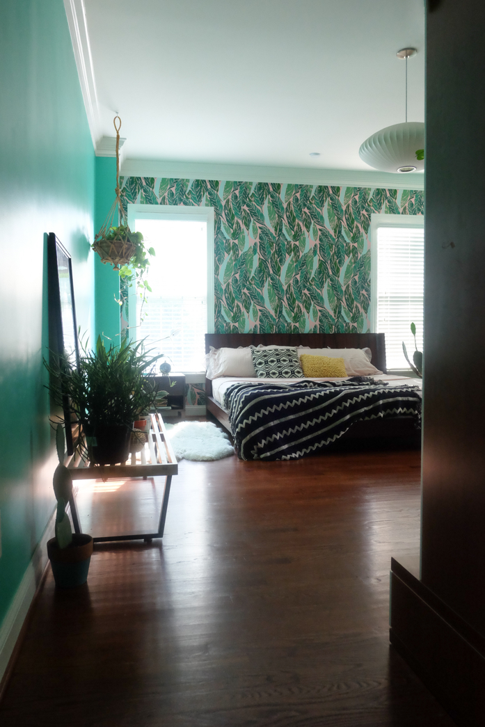 Design addict mom's colorful and plant filled bedroom featuring Justina Blakeney's Nana wallpaper.