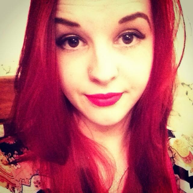 selfie of red haired girl wearing pink lipstick