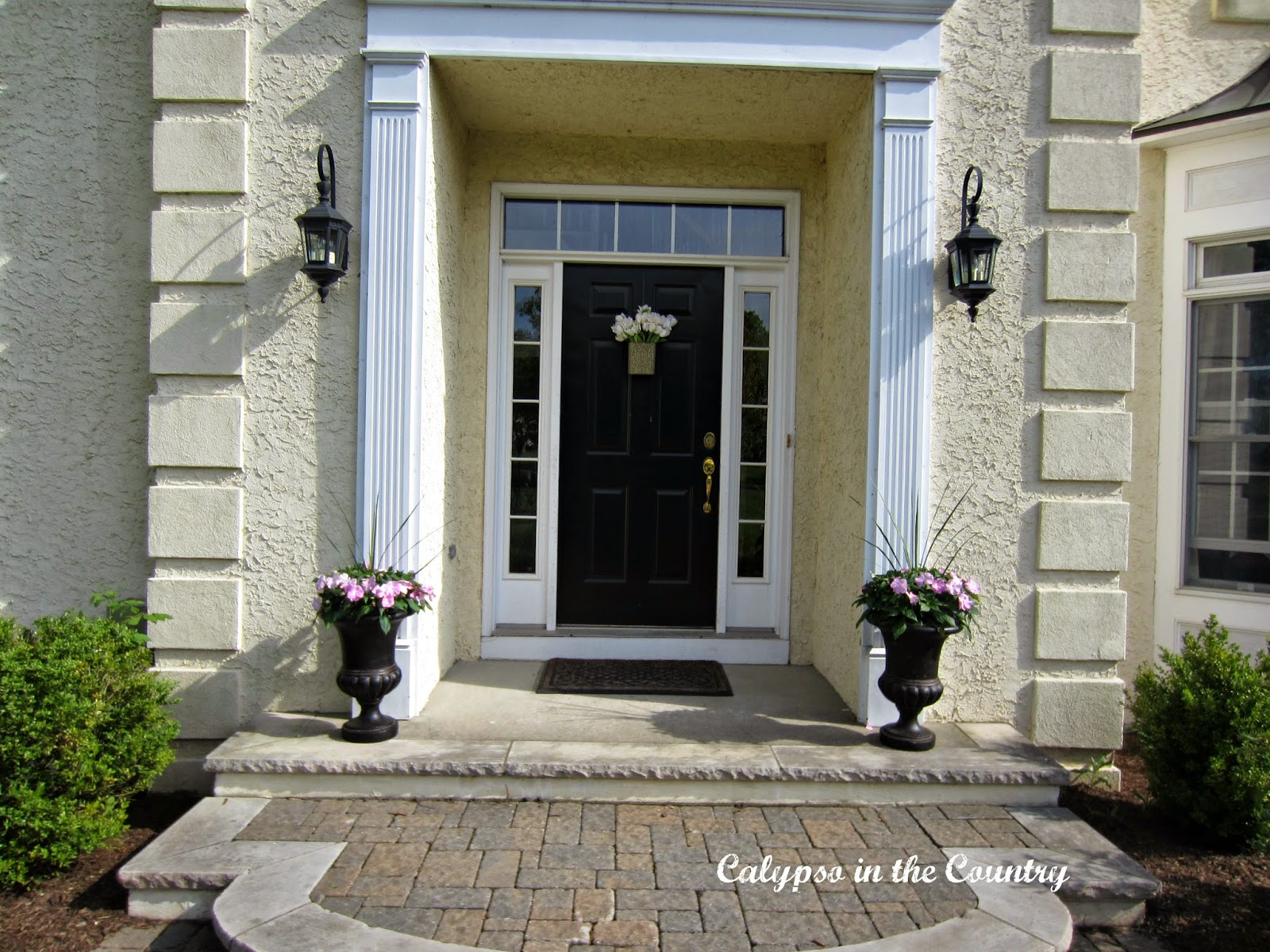 Spring Front Porch with Black Urns