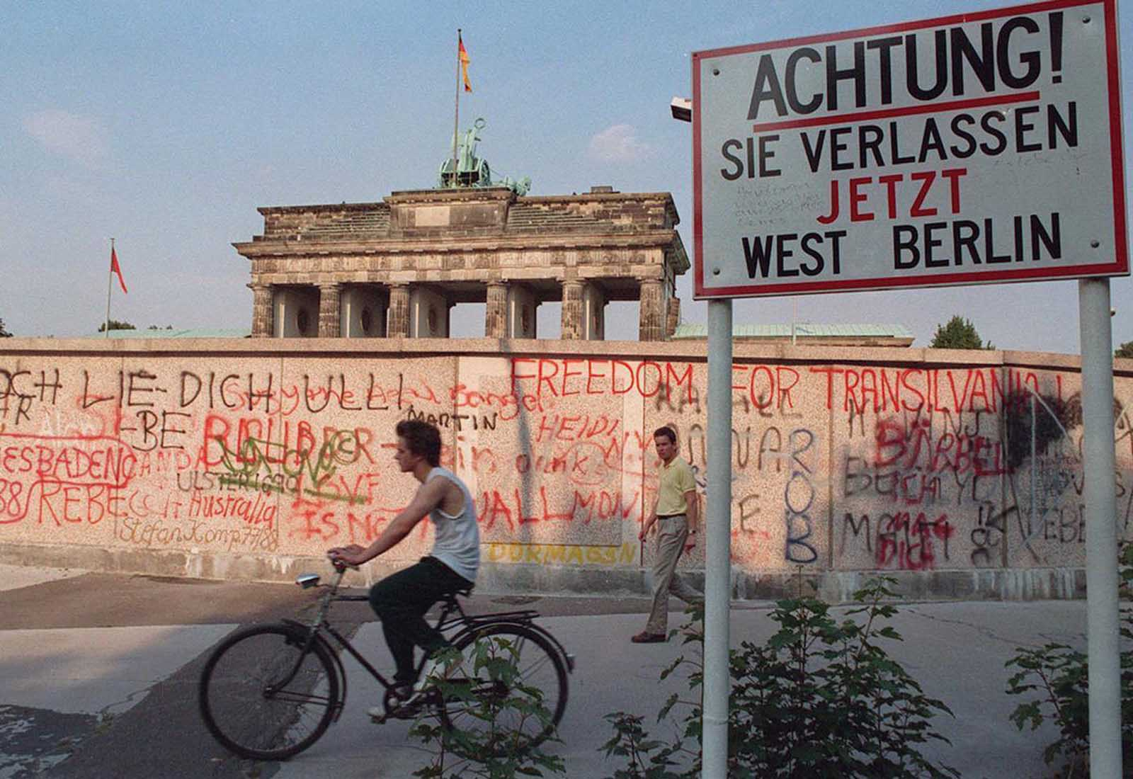 A graffiti-covered section of the wall close to the Brandenburg Gate in Berlin in 1988. Sign reads: