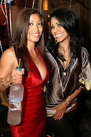 Babes holding a bottle of drink in a nightclub