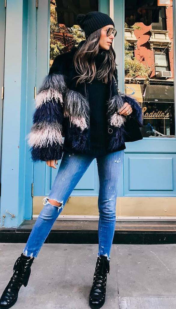 winter outfit idea / hat + bag + sweater + fur jacket + ripped jeans + boots