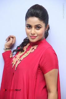 Actress Poorna Latest Stills in Red Dress at Rakshasi First Look Launch  0141.JPG