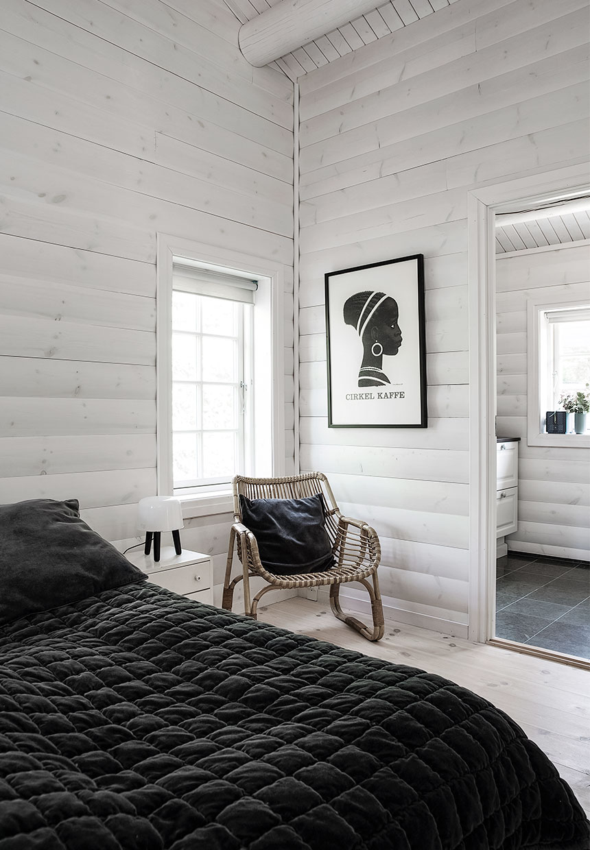 inside of a log cabin, scandinavian interior design, black and white, bedroom