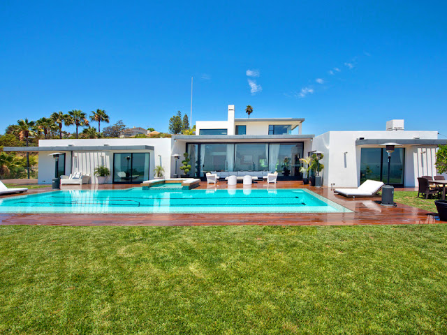 Photo of amazing bel air modern residence with the pool as seen from the lawn in the backyard