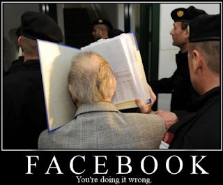funny lol lmao rofl pic about the name facebook showing a man trying to insert his face in book
