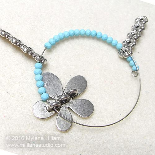 Adding the flower slider to the bracelet design.