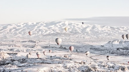 Hot Air Balloons over the Snowy Landscape