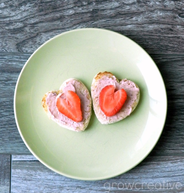 Make Valentine's Toast with Heart shaped bread, cream cheese,and strawberries: growcreative