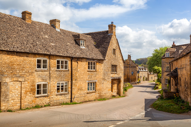 Honey coloured houses in Guiting Power in the Gloucestershire Cotswolds